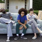 Neslan Ellis as Mack Burns, Armani Jackson as Clark Burns, and Melanie Lynskey as Gina McNulty-Burns in LITTLE BOXES. Photo by: Mark Doyle